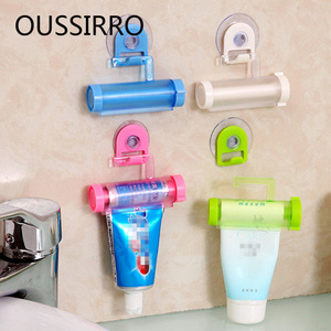HOT Bathroom Home Tube Rolling Holder Creative Multipurpose Toothpaste Dispenser Bathroom Accessories Manual Syringe Gun Dispens