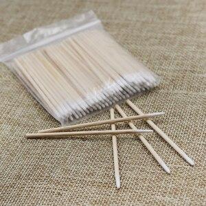 Image 1 - Palillos de algodón para tatuaje con cabeza de madera puntiaguda, belleza profesional para tatuaje bastoncillo de algodón, para cejas, labios, 100 unidades por lote