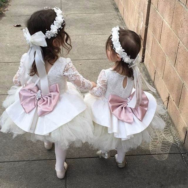 Puffy Pink Lace Appliques Flower Girl Dresses with Bow Crystals Sash Lovely Kids Wedding Birthday Party Ball Gowns custom nice sheer short lace sleeve boat neckline ball gowns long pleated appliques wedding birthday party flower girl dresses