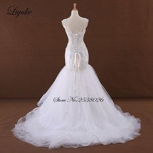 Image 4 - Liyuke J170 אלגנטי טול בת ים חתונת שמלה מתוקה אפליקציות ואגלי ספגטי רצועות הכלה שמלת robe דה נישואים
