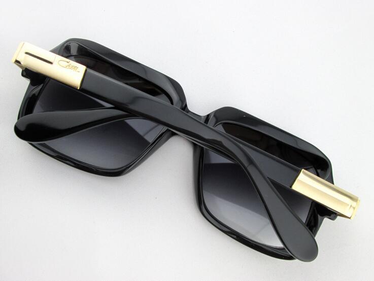 bd80ac4a5f3a2c 2015 mode CAZAL 607 VINTAGE légende lunettes de soleil hommes et femmes or  noir cadre gris objectif neuf avec boîte d origine dans Costumes de  vacances pour ...