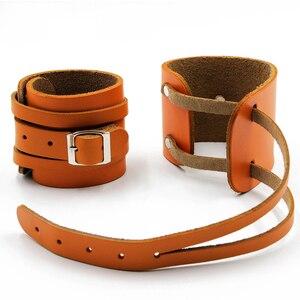 Image 1 - Muñequera de cuero de vaca para levantamiento de pesas, Protector de muñeca para Crossfit, con prensa de barra, pulsera para gimnasio, 1 par