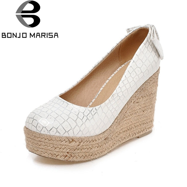 279375a2cb90 BONJOMARISA-Spring-Autumn-Fashion-Bling-Fretwork-Women-Pumps -Big-Size-33-43-Shallow-Platform-High-Wedges.jpg 640x640.jpg