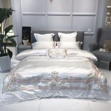 مفرش سرير فاخر أبيض مطرز أنيق أوروبي 4/7 قطعة غطاء لحاف حريري ساتان مفرش سرير قطن ناعم للغاية مفرش سرير كوين كينج