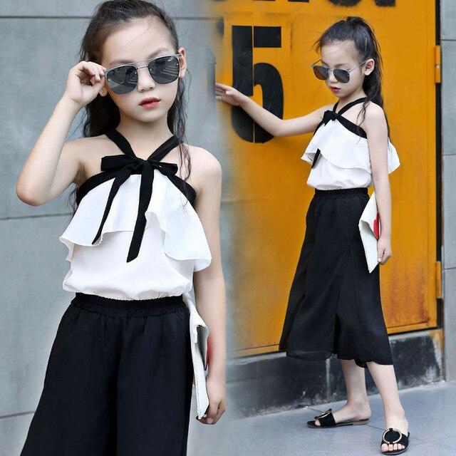 0e732e6c5 La escuela de los niños conjuntos de ropa para niñas hombro blanco blusas y  Negro faldas