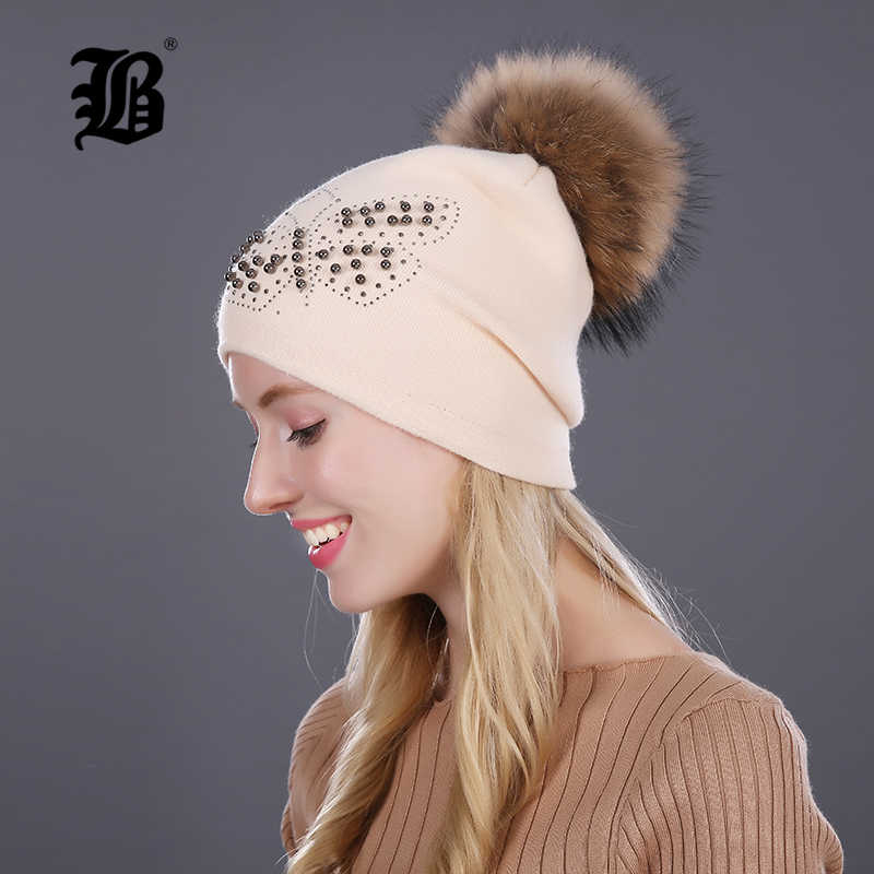 [FLB] ニット女性の帽子毛皮の帽子女性ビーニー蝶キャップ少女毛皮ポンポン Poms とウールニット帽子新厚い女性キャップ