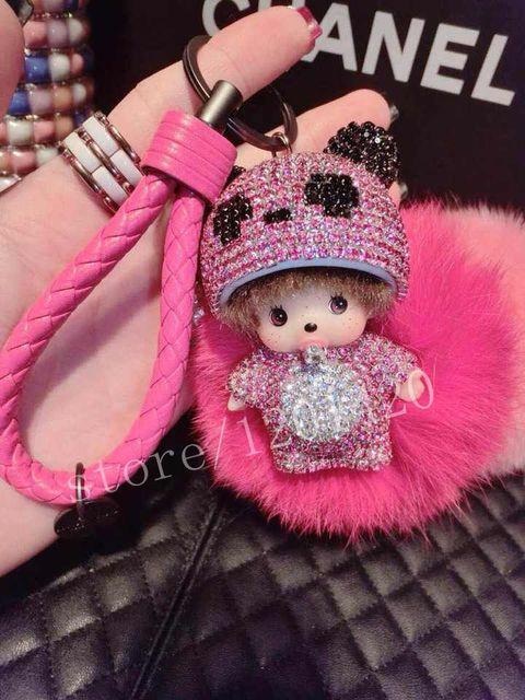 Monchichi bola de la piel de color de rosa caliente capa Panda Crystal verdadera piel hechos a mano del bolso del coche encanto clave muchacha linda anillos del encanto del bolso etiqueta