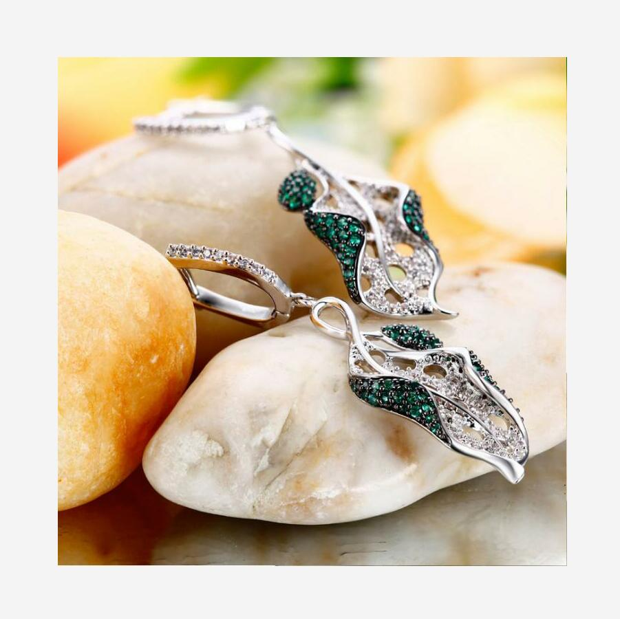 New 925 sterling silver one leaf one world European and American fashion earrings women J0177 in Earrings from Jewelry Accessories