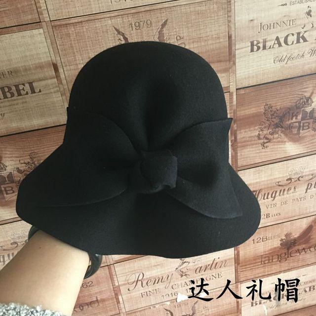 Europa y estados unidos gran bowknot adorna cuenca of the mismo color gorra de paño atmosférica pescador cap joker sombrero femenino