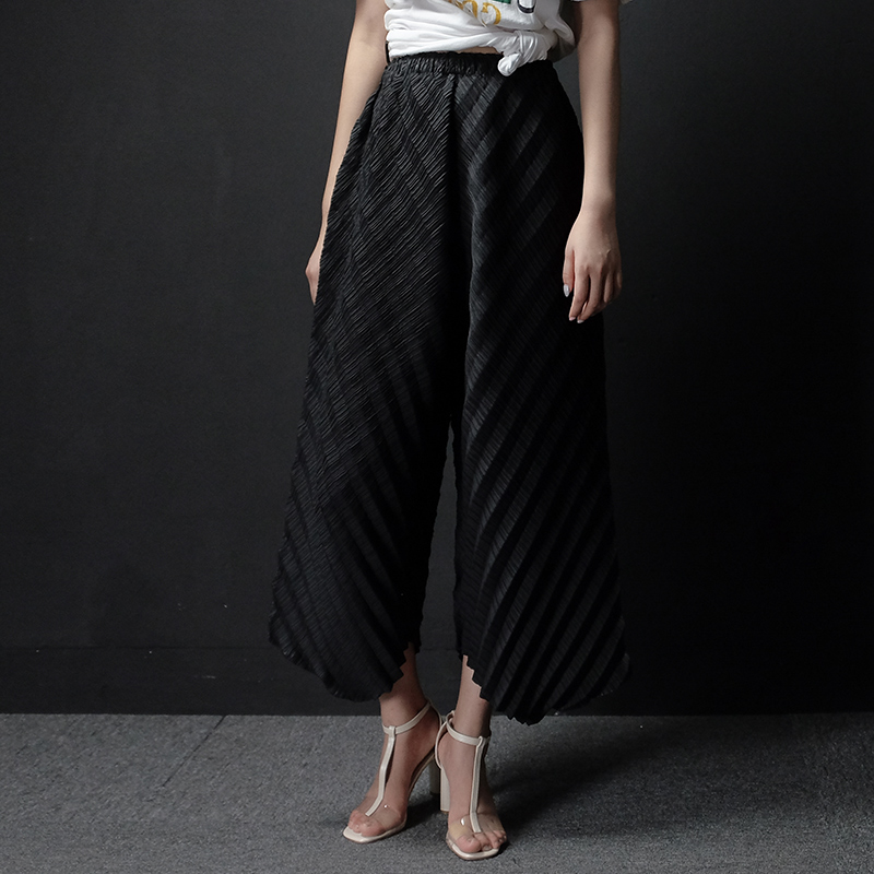 FREE SHIPPING Miyake pleated wide leg pants personality fashion spring and summer culottes irregular IN STOCK