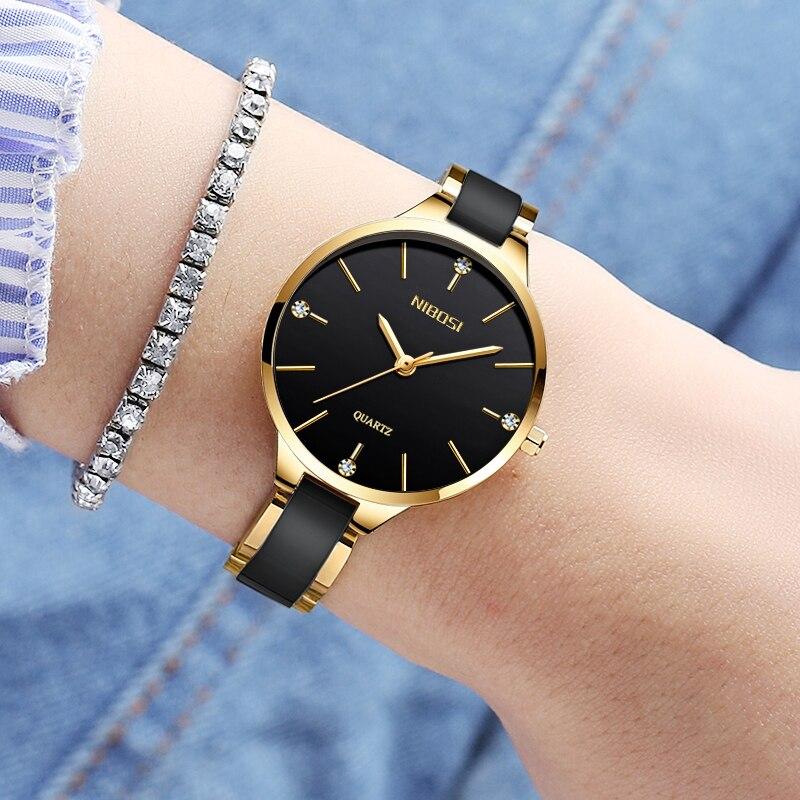 цена на Women Watches NIBOSI Top Brand Luxury Rhinestone Watch Gold White Women's Bracelet Ceramics Quartz Wristwatch Relogio Feminino