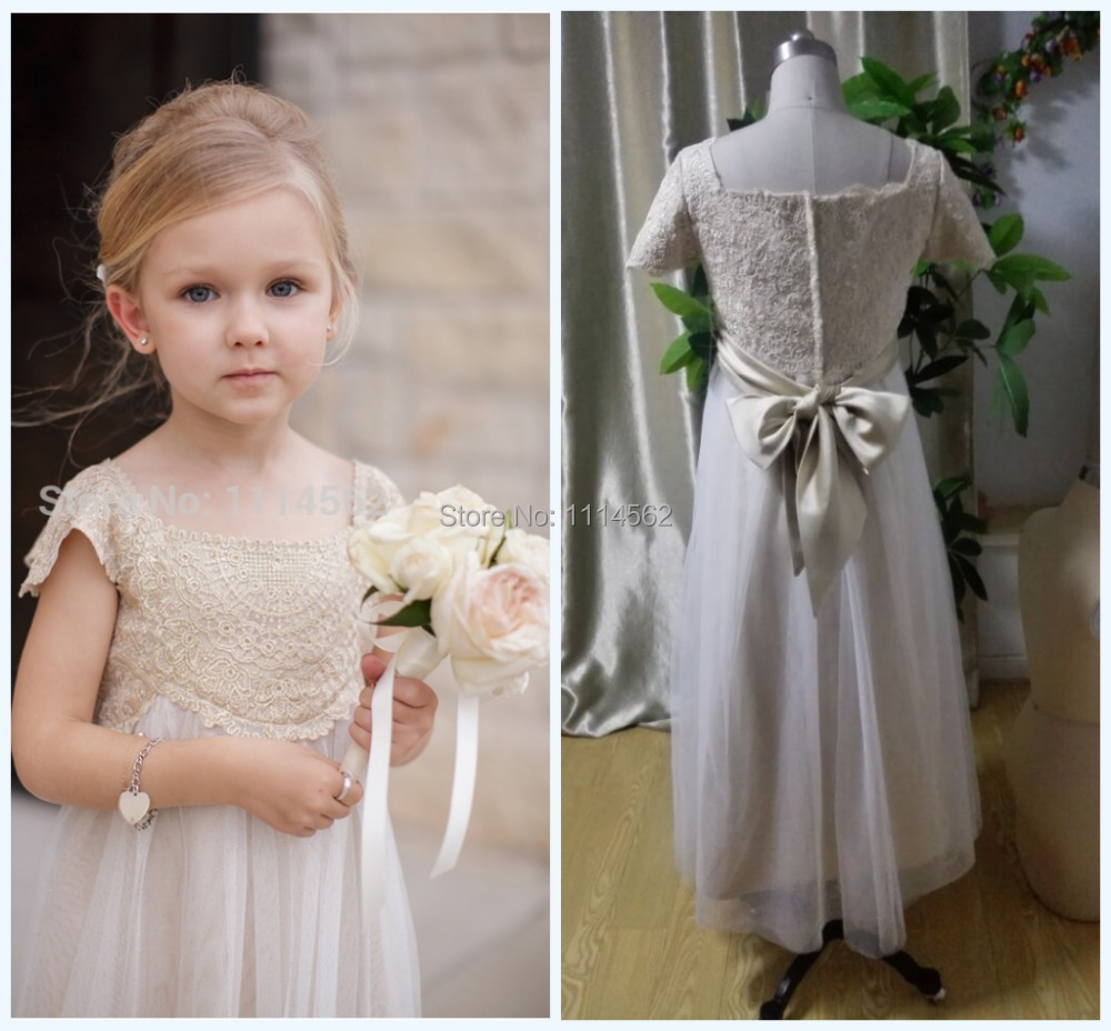 Real-Sample-Romantic-A-Line-Flower-Girl-Dresses -For-Wedding-2014-Short-Sleeve-Tulle-Champagne-Lace.jpg