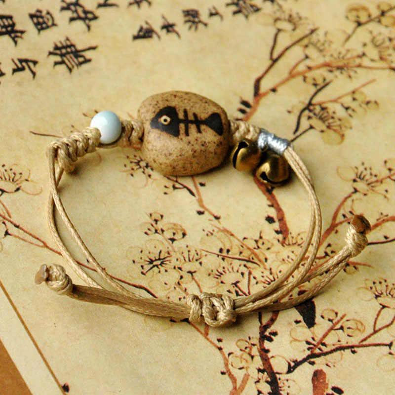 Pesce Braccialetti Perline di Ceramica Braccialetto di Fascino Campana di Bronzo Pendente della Corda Del Tessuto Braccialetti Donna Uomo Braccialetti Gioielli Accessori