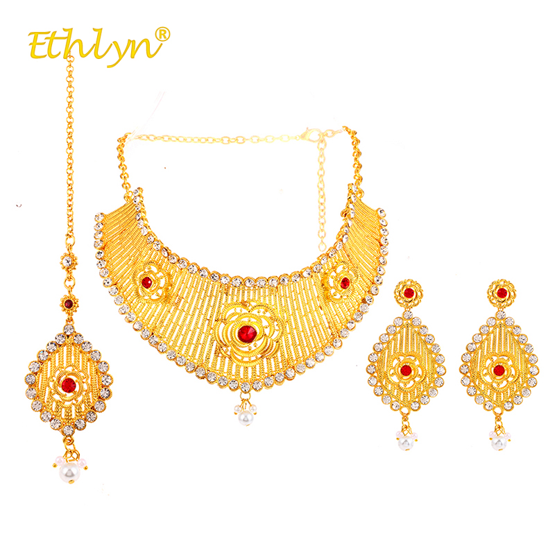 Ethlyn Women India Kundan Jewelry Set Red Acrylic Crystal Pearl Luxury Hollow Big Necklace/Dangle Earrings/Hairwear Gold ColorEthlyn Women India Kundan Jewelry Set Red Acrylic Crystal Pearl Luxury Hollow Big Necklace/Dangle Earrings/Hairwear Gold Color
