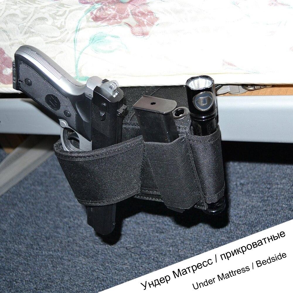 Oculto bajo colchón cama lado pistola coche asiento del asiento ...