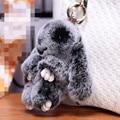 13 cm Nueva Lindo de Piel de Conejo Bolso Del Coche Llavero Colgante Encanto Anillo de la Cadena dominante Mini Conejo Juguetes de la Muñeca Para Las Mujeres Regalo joyería