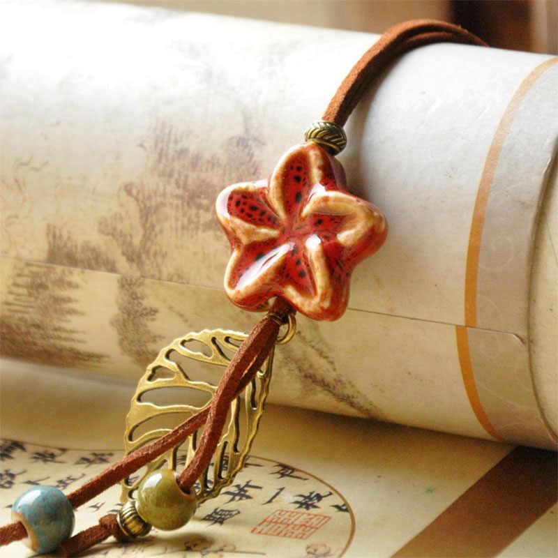 ดาวสร้อยคอลูกปัดเซรามิกกลวงใบดอกไม้จี้ชี้แจงเสน่ห์หนังเชือกเค้นคอPUสายโซ่เครื่องประดับผู้หญิง