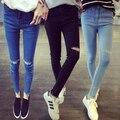 Barato al por mayor 2016 nueva venta Caliente Del Otoño Invierno moda mujer casual estudiante populares agujeros muestran finas pequeños pies de vaquero pantalones