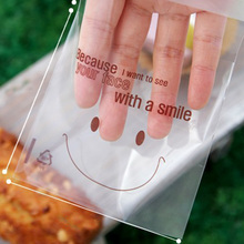 100pcs Smile Face BreadGift Food Plastic Bags Cute Small Biscuit Bag Party Favor Cellophane Bags(China (Mainland))