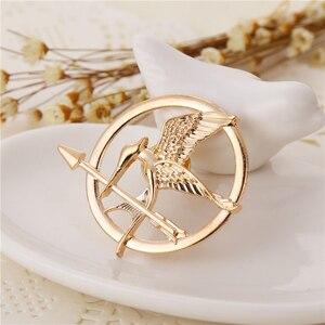 Image 4 - Hunger Games Brooch Pin Bird Eagle Arrow Logo Badge Vintage Fashion Hot Animal Game Movie Jewelry For Men Women Kids Wholesale