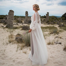 فستان أعراس أنيق بالتل الأبيض موديل راقي موسم العيد