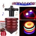 El nuevo flash giroscopio giroscopio colorido luces de Peg-Top spinning Manual LED música beyblade top venta del envío mejores juguetes