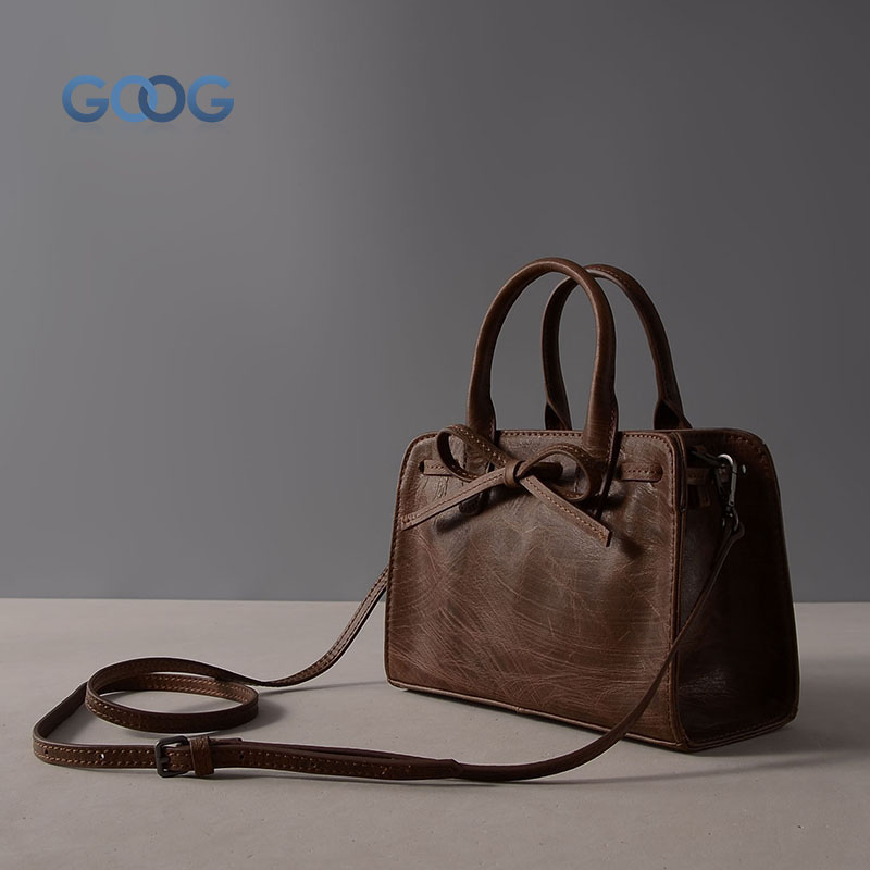New leather belt with small square bag retro fashion bowknot leather ladies bag first layer of cowhide solid color classic porta retro art oval leather shoulder bag new korean version of the wave of fashion ladies first layer of leather zipper multi color b