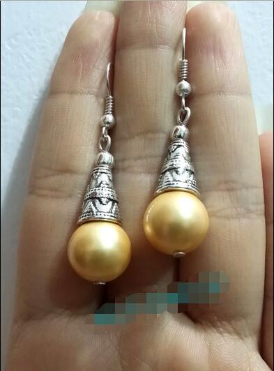 >> Красивый 12 мм золотой жемчуг Золотой оболочки Тибетский серебряный Мотаться серьги