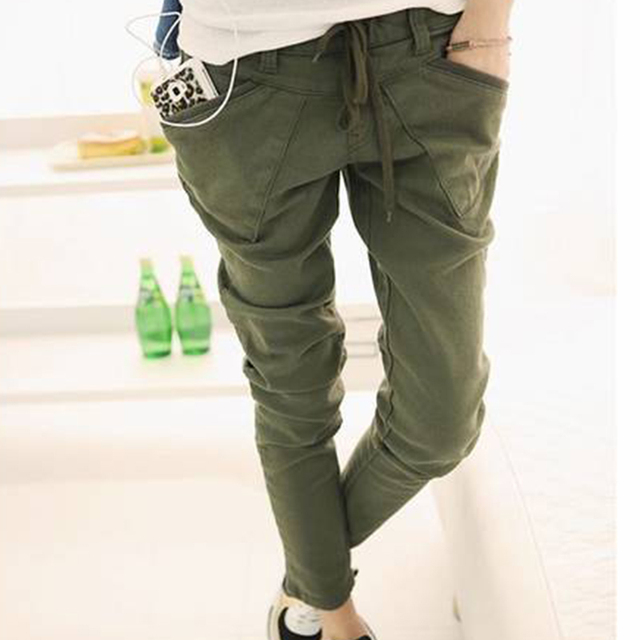 Simple white tshirt with army green jeans olive skinny jeans and brown ankle boots combat boots minus the furry vest Khaki green pants, brown combat bootss, white t .