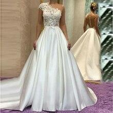 אשליה אונליין אחד כתף אלגנטי סאטן חתונת שמלות חרוזים תחרת Applique פורמליות כלה שמלות כלה 2020 אורך קיר