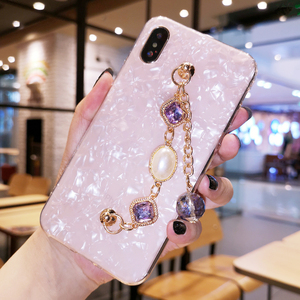 Image 1 - Fancy Pearl Crystal Stone Tassel Diamond Chain Bracelet Shell Phone Case For Huawei P30 P40 Lite Mate 20 30 Pro Y9 Prime 2019