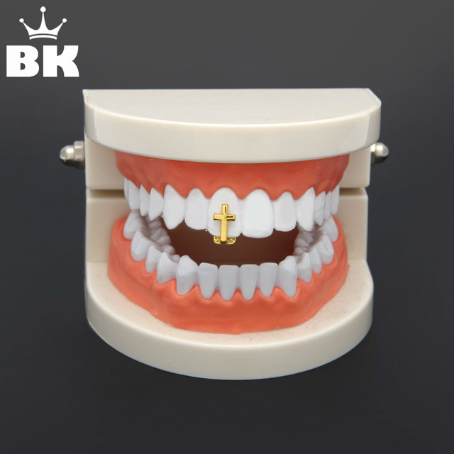 Single Cross TeethGrillz Gold Color Canine One Tooth Grills Upper Hip Hop  Top Fangs Hollow Grill f41e1c3282