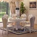 Из натурального дерева обеденный стол с резьбой