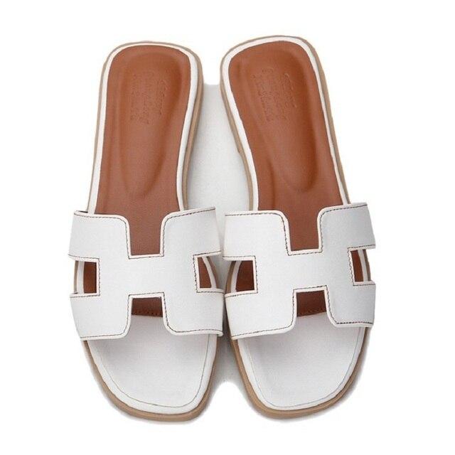 แบรนด์หรูใหม่รองเท้าแตะตัด out summer beach รองเท้าแตะแฟชั่นผู้หญิงสไลด์รองเท้าแตะกลางแจ้งในร่ม slip flip flops