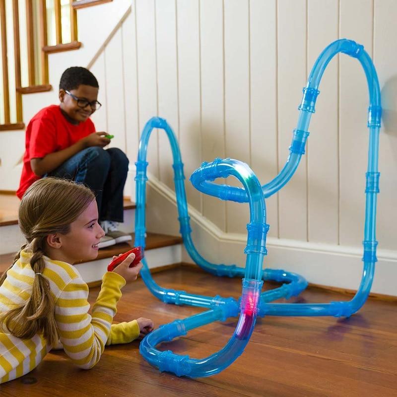 Doigt Rock D'origine Télécommande Zipes Vitesse Tuyaux Suivre Voiture Jouets DIY De Construction Pipe Piste de Course Ensemble Flash Lumière Enfants jouets