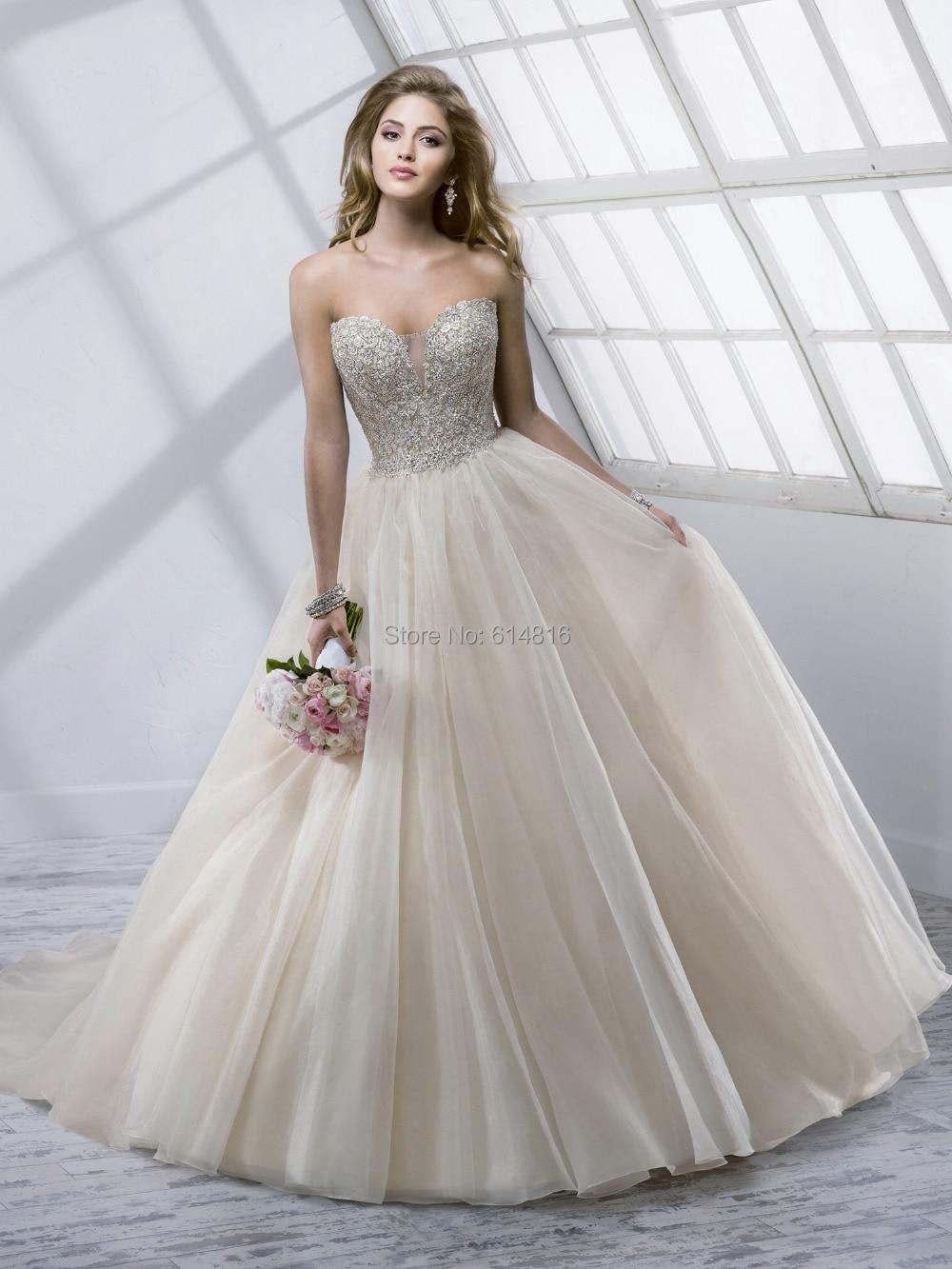 marchesa wedding dresses bridal fashion week spring romantic wedding dresses Marchesa Spring long sleeve wedding dress with plunging neckline and 3 D floral appliqu