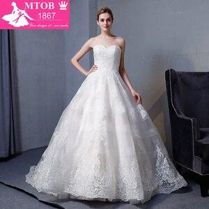 Image 1 - Nuevos vestidos de novia de encaje Línea A de diseño 2018 escote corazón sin espalda elegante Sexy Vintage vestidos de boda china tienda en línea MTOB1817