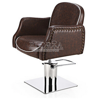 Upscale barber chair. Retro hairdressing chair. Hair salons dedicated hairdressing chair.