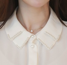 MIARA.L new double-layer high-quality pearl water-drill shirt collar sweater for spring 2019,fake necklace