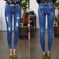 2016 плюс размер джинсы женщина отверстие эластичные тощие брюки карандаш брюки зима лодыжки длина брюки рваные джинсы женщина xl-5xl