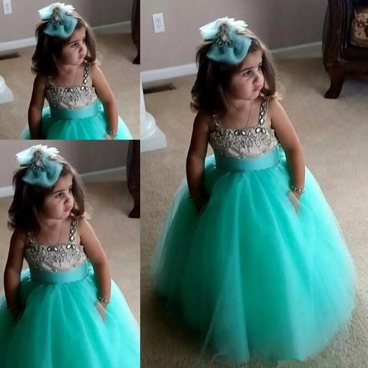 New pretty mint a line flower girls dresses tulle crystal spaghetti straps ball gown full length lovely baby girl birthday gown baby fashion prom ball gowns tea length bateau neckline tulle flower mint blue tutu vestidos backless back mint girls dress