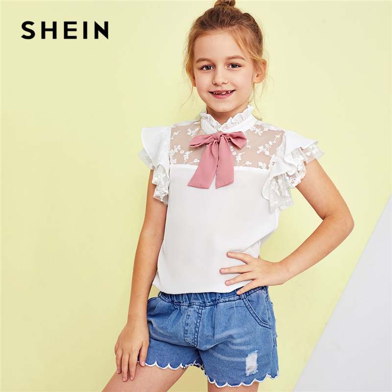 цены на SHEIN Kiddie White Stand Collar Bow Front Mesh Insert Cute Girls Tops 2019 Summer Cap Sleeve Embroidery Ruffle Preppy Blouses