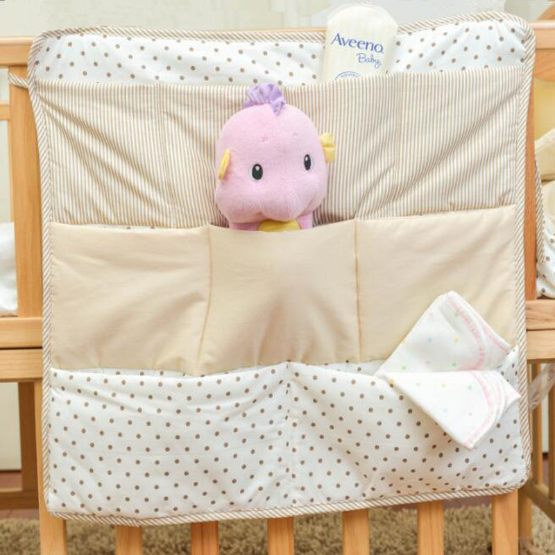 new 100 cotton crib organizer baby cot bed hanging storage bag toy diaper pocket for newborn. Black Bedroom Furniture Sets. Home Design Ideas