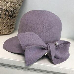 Image 1 - אלגנטי פורמליות נשים צמר כובע חם הרגיש חורף פדורה כובע פרל Bowknot הקלוש Bowler כובע גבירותיי המפלגה דרבי כנסיית חתונה כובע