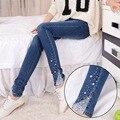 Мода новых женщин вышитые вспышки кружева лоскутные джинсы дамы стильный slim fit mid талии молния джинсы брюки