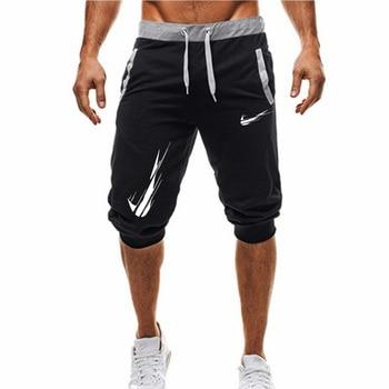 2e35791452 Nueva moda de verano de los hombres de ocio de la longitud de la rodilla  pantalones cortos de Color sólo romper pantalón corto Pantalones Hombre  Shorts y ...