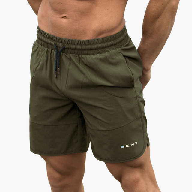 2b9b2374cd536 Verano hombres correr Jogging Shorts gimnasio Fitness culturismo  entrenamiento deportes ropa deportiva hombre Pantalones cortos hasta