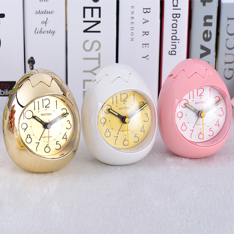 RHYTHM Cute Egg Shape Alarm Clock Ultra Silent Jumping Movement Clock Tumbling Beep Alarm,See-Through Pack White/Pink/Gold Color