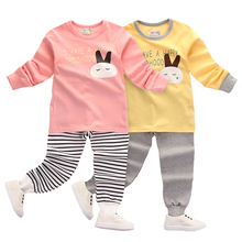 Купить с кэшбэком Fashionable Cartoon Cotton Children Pajamas Set for Girls Baby New Year Rabbit Letter Printed Cute Warm Sleepwear Kids 2t to 14
