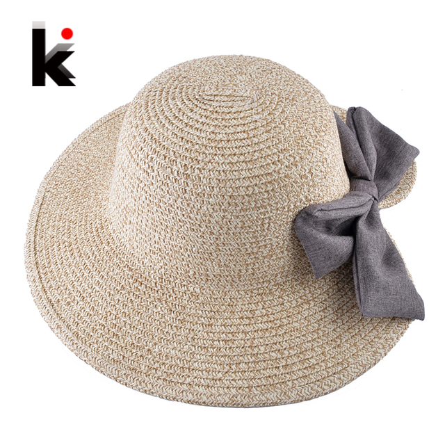 28cbce1a Summer Sweet Bow-knot Sun Hat For Women Crocheted Raffia Wide Brim Straw  Cap Ladies Sun Protection Beach Hats Girl Chapeau Femme